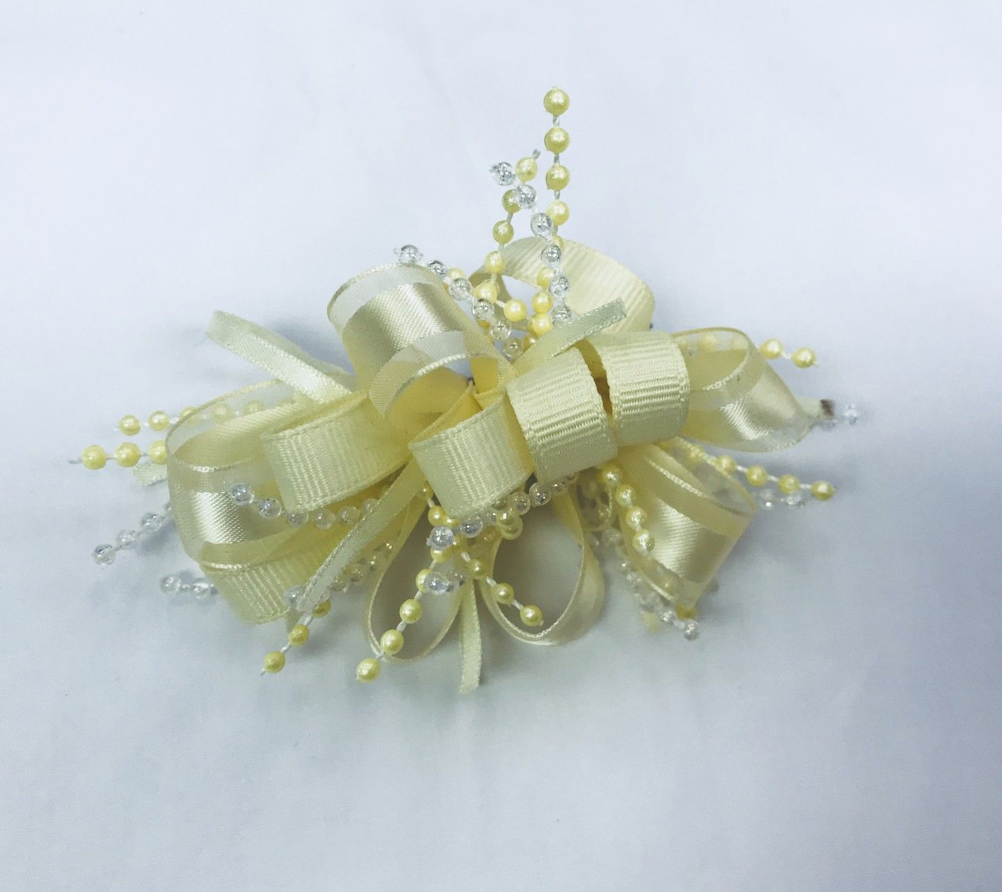 CHEE CHEE IVORY BOW WITH BEADS