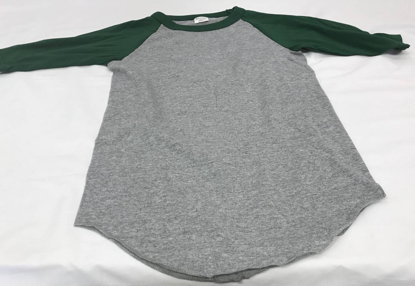 Dark green and gray baseball shirt with Property of St. Thomas the Apostle logo