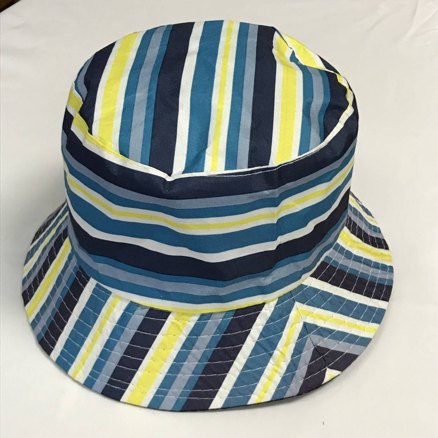BLUE AND YELLOW REVERSIBLE BUCKET HAT AGES 12+